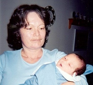 My Mother with my first baby a few hours after birth.