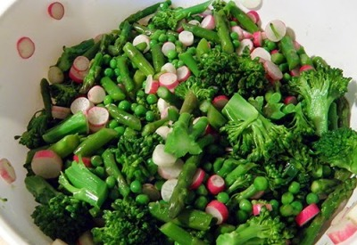 Colander of broccolini, peas, asparagus, and peas